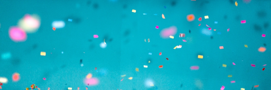 Colourful confetti on a turquoise background